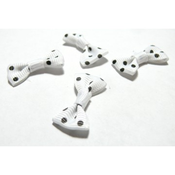 Apprêt et mercerie Lot de 4 noeuds blanc PQZ25-16